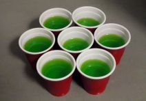 Jelly shots in cute little red cups.